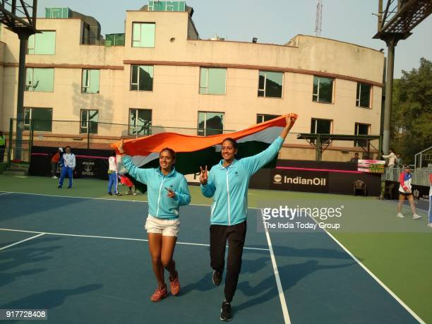 Ankita Raina and Karman Kaur Thandi celebrate after winning against Chinese Taipei in the Fed Cup in New Delhi