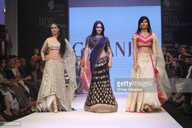 Ankita Shorey Bipasha Basu Vanya Mishra walk the runway in a Gitanjali Jewellery design at the India International Jewellery Week 2012 Day 4 at the...