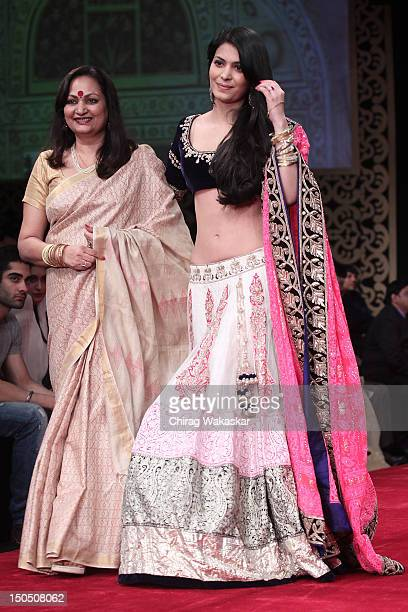 Ankita Shorey Neelam Shorey walk the runway in a Gitanjali design at the India International Jewellery Week 2012 Day 1 at the Grand Hyatt on on...