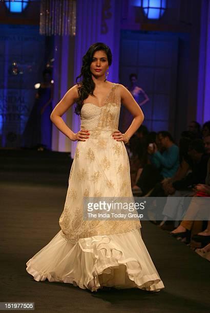 Ankita Shorey showcases a creation by Indian designer Jyotsna Tiwari during Aamby Valley India Bridal Fashion Week 2012 in Mumbai