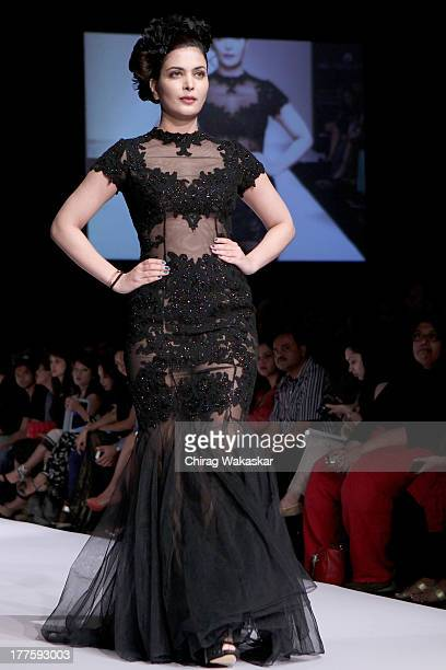Ankita Shorey showcases designs by Rocky S on the runway during day 2 of Lakme Fashion Week Winter/Festive 2013 at the Hotel Grand Hyatt on August 24...