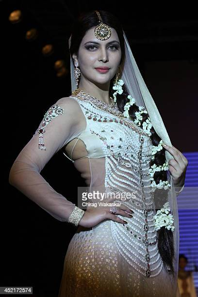 Ankita Shorey walks the runway at Gitanjali Gems show during day 1 of the India International Jewellery Week 2014 at grand Hyatt on July 14 2014 in...