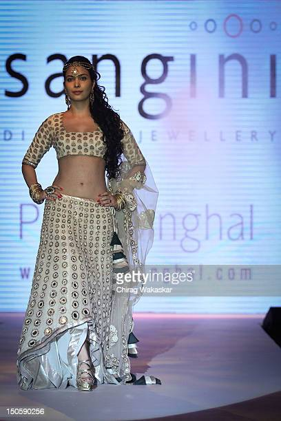 Ankita Shorey walks the runway in a Gitanjali Sangini Jewellery design at the India International Jewellery Week 2012 Day 4 at the Grand Hyatt on...