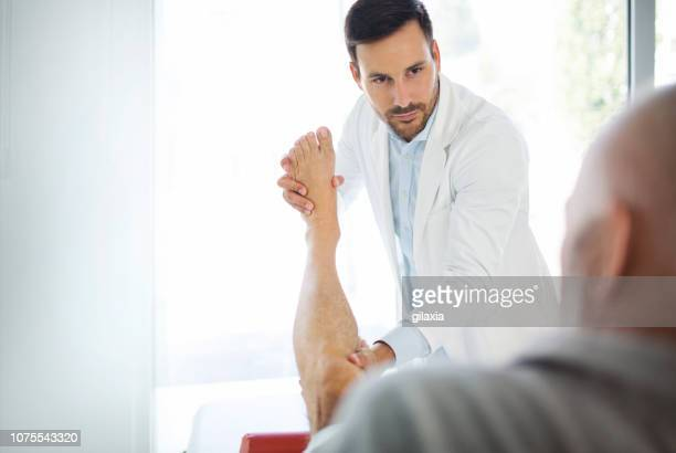 ankle examination. - sciatic stock photos and pictures