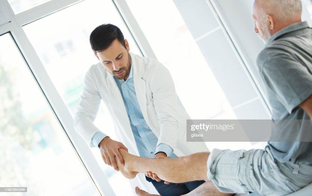 Ankle examination. : Stock Photo