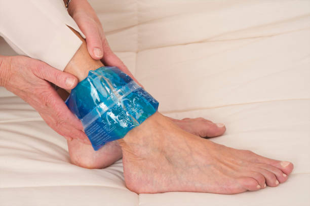 ankle pain elderly person - warm compress stock pictures, royalty-free photos & images