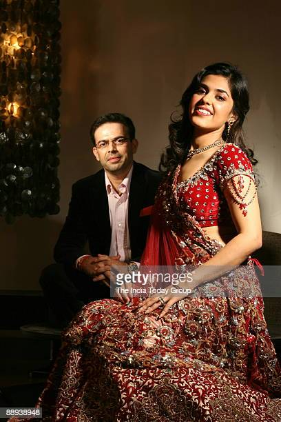 Ankur Batra Designer and wedding planner in a fitting session with city bridetobe Anchal Jain he organises decorates and executes high profile...