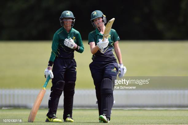 Anlo van Deventer of the Central Hinds celebrates her half century during the Hallyburton Johnstone Shield match between the Canterbury Magicians and...