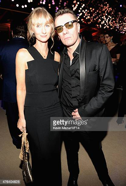 Ann Acheson and Larry Mullen Jr attend the 2014 Vanity Fair Oscar Party Hosted By Graydon Carter on March 2 2014 in West Hollywood California