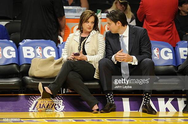 Ann and Josh Kroenke chat before game 7 of the first round of the NBA playoffs Saturday May 12 2012 at Staples Center in Los Angeles California