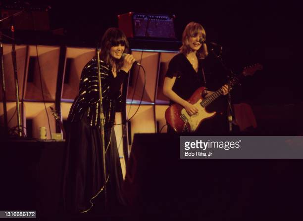 Ann and Nancy Wilson of group HEART perform in concert July 15, 1977 in Los Angeles, California.