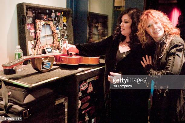 Ann and Nancy Wilson of Heart signing a guitar on September 24, 2007 in New York City.