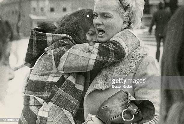 Ann Arbeely right who was reportedly hit by a chair embraces her daughter Laurie outside Hyde Park High School on Jan 21 after a midmorning melee...