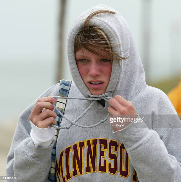 Ann Arnason visiting from Grand Forks North Dakota adjusts her hood as she walks along Lake Michigan October 15 in Chicago Illinois Cool weather has...