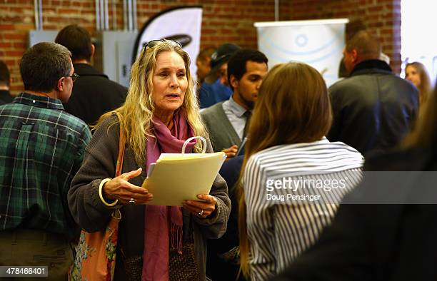 Ann Bell of Denver talks with business owners at CannaSearch, Colorado's first cannabis job fair, on March 13, 2014 in Denver, Colorado. O.PenVAPE,...