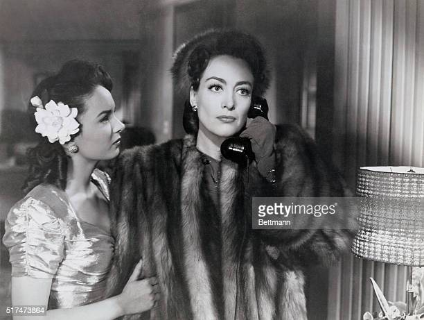 Ann Blyth and Joan Crawford star in the Warner Brothers' drama, Mildred Pierce which was directed by Michael Curtiz.