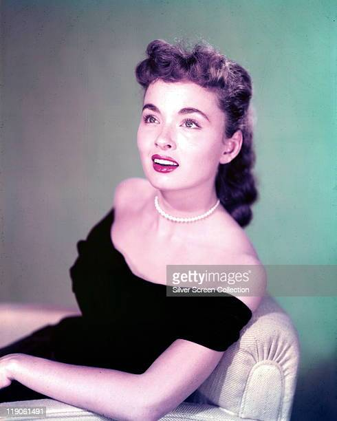 Ann Blyth US actress wearing a black shoulderless dress and pearl necklace in a studio portrait circa 1950