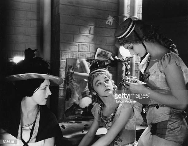 Ann Casson has a backstage conversation in a scene from the film 'Dance Pretty Lady', an early talkie based on the novel 'Carnival' by Compton...
