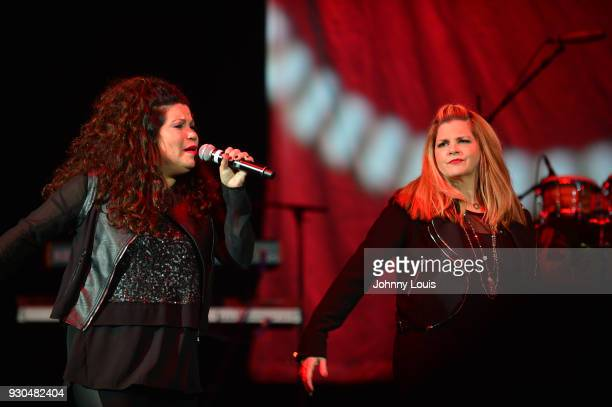 Ann Curless and Jeanette Jurado of Expose perform during the Freestyle concert at Watsco Center on March 10 2018 in Coral Gables Florida