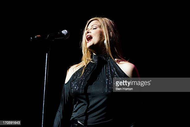 Ann Curless of Expose performs at the HOT 923 Freestyle Explosion at Gibson Amphitheatre on June 14 2013 in Universal City California