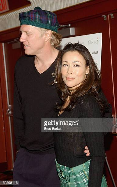 Ann Curry and guest watches arrive at the Johnnie Walker Presents Dressed to Kilt fashion show at the Copacabana on April 6 2005 in New York