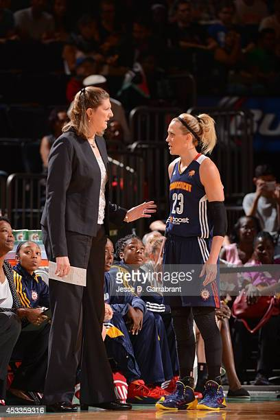 Ann Donovan and Katie Douglas of the Connecticut Sun talk against the New York Liberty during the game on August 8 2014 at Madison Square Garden in...