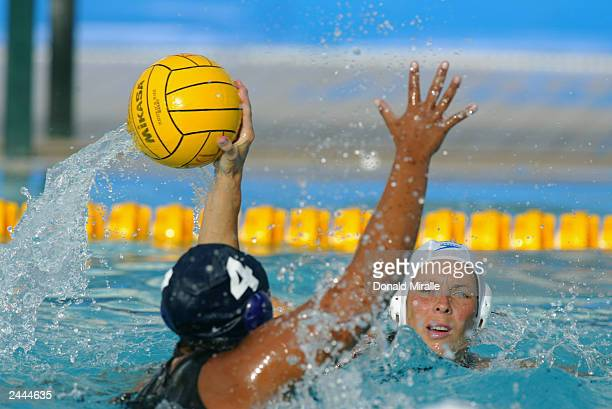 Ann Dow of Canada goes to pass the ball as Brenda Villa of the USA guards during the USA's 73 win over Canada during the Women's Water Polo Final at...
