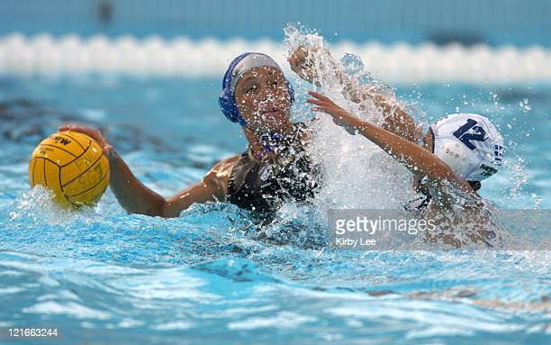 Ann Dow of Canada is defended by Antonia Moraiti of Greece during fifthplace match of the FINA Women's Water Polo World League Super Final on Sunday...