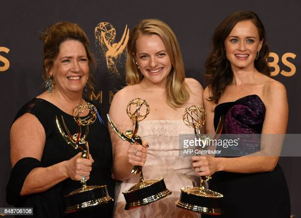"""Ann Dowd, Elisabeth Moss and Alexis Bledel pose with the award for Outstanding Drama Series for """"The Handmaid's Tale"""" during the 69th Emmy Awards at..."""