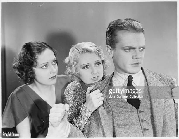 Ann Dvorak and Joan Blondell hold back James Cagney in a scene from the 1932 film The Crowd Roars
