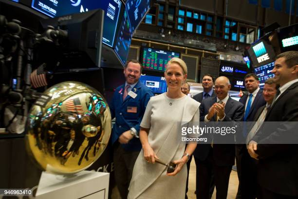 Ann Fox president and chief executive officer of Nine Energy Service Inc center holds a gavel after ringing a ceremonial bell celebrating the...