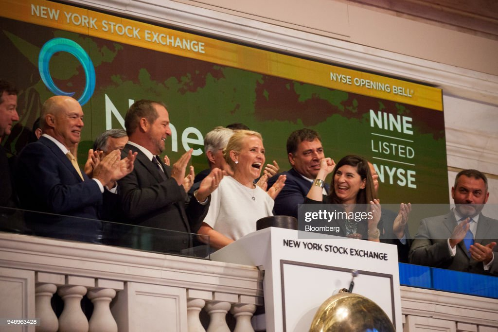 Ann Fox, president and chief executive officer of Nine Energy Service Inc., center, rings the opening bell on the floor of the New York Stock Exchange (NYSE) in New York, U.S., on Monday, April 16, 2018. U.S. stocks rallied and Treasuries slid as geopolitical tensions eased and investors turned their attention to corporate results. Photographer: Michael Nagle/Bloomberg via Getty Images