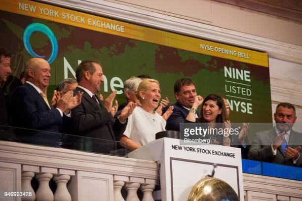 Ann Fox president and chief executive officer of Nine Energy Service Inc center rings the opening bell on the floor of the New York Stock Exchange in...