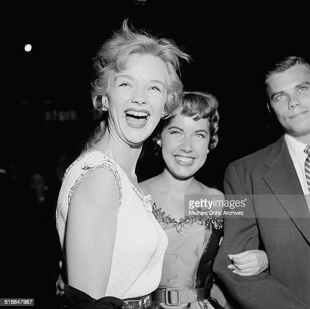Ann Francis Terry Moore and Dr Nielson attend a movie premiere in Los AngelesCA