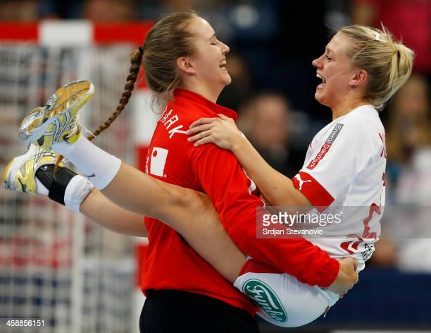 Ann Grete Norgaard Osterballe and goalkeeper Cecilie Greve of Denmark celebrate their victory after the World Women's Handball Championship 2013...