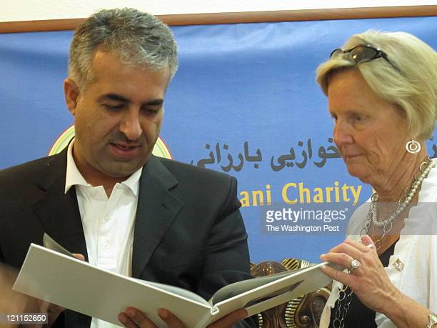 Ann Hampton right shows Mousa Ahmed deputy director of the Barzani Charity Foundation photos of her daughter Kimberly Hampton a US military...