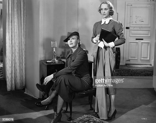 Ann Harding the American leading lady and Binnie Hale the British revue comedienne in a scene from 'Love From A Stranger' directed by Rowland V Lee...