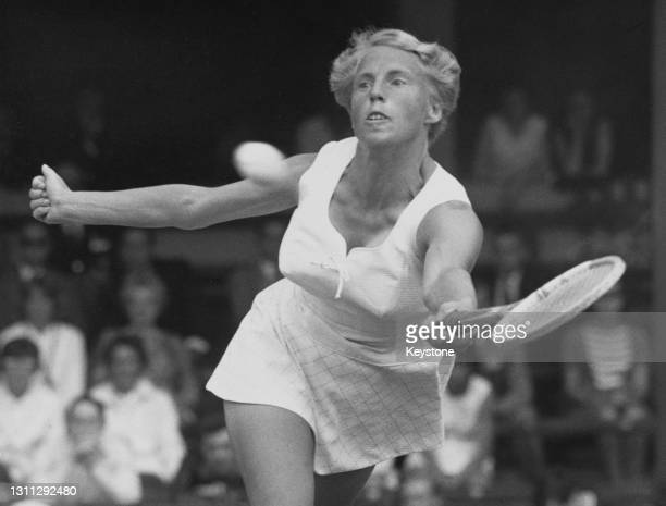 Ann Haydon-Jones of Great Britain reaches to make a forehand return shot to Nancy Richey of the United States during their singles match of the 38th...