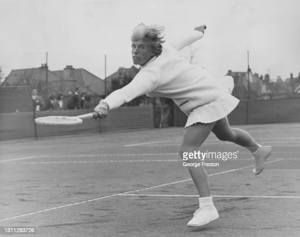 Ann Haydon-Jones of Great Britain watches the tennis ball while reaching to make a backhand return shot to Jenny Wagstaff during their Women's...