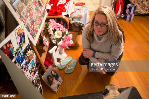 Ann Howgate looks at photos of her daughter that were shown at her funeral Her home is filled with photos and memories of her late daughter Kristina...