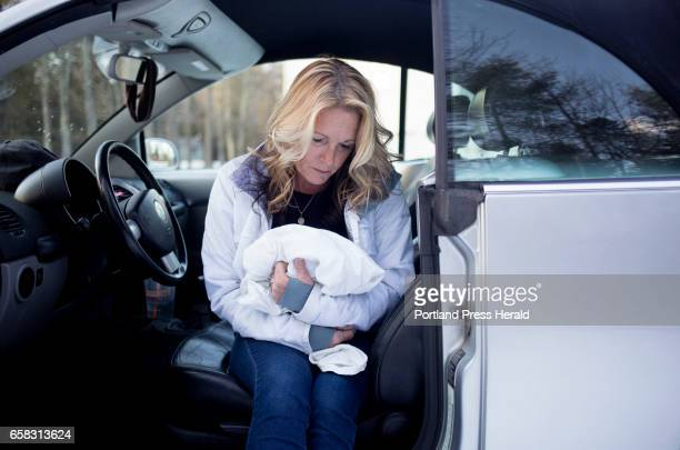 Ann Howgate mother of Kristina Emard poses for a portrait in her daughters car holding the blanket that Emard's body was covered up with Emard died...