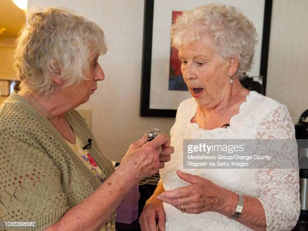 Ann Hunt left Aldershot England presents her twin sister Liz Hamel of Albany Oregon with an alarm clock during their reunion at the Fullerton...