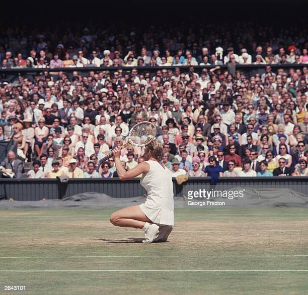 Ann Jones crouching on the ground after losing a crucial point during the Ladies singles final at Wimbledon which she lost to Billie Jean King