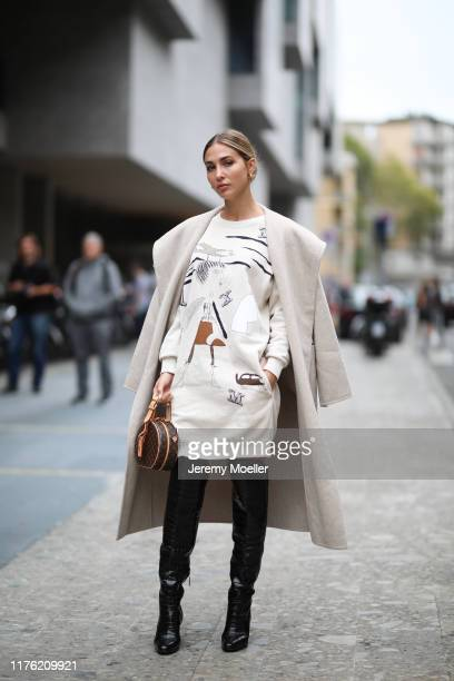 Ann Kathrin Goetze wearing a complete Max Mara look and a Louis Vuitton bag and poses outside the Max Mara show during Milan Fashion Week...
