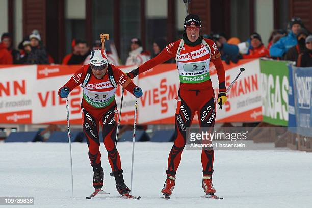 Ann Kristin Aafedt Flatland of Norway hands over to her team mate Ole Einar Bjoerndalen at the mixed relay during the IBU Biathlon World...