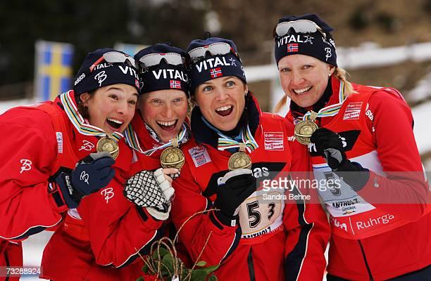 Ann Kristin Flatland Tora Berger Jori Moerkve and Linda Grubben of Norway present their bronze medals from the Women's 4 x 6 km Relay in the Biathlon...