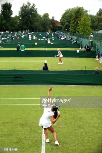 Ann Li of The United States serves during her ladies singles match against Jana Cepelova of Slovakia during qualifying prior to The Championships,...