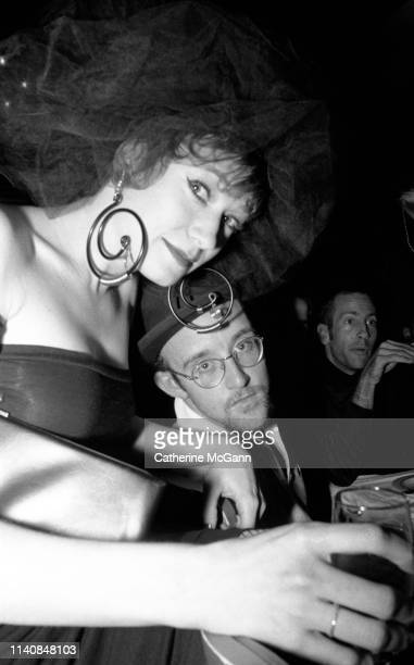 Ann Magnuson and Keith Haring at a party at Guignol's restaurant in April 1987 in New York City New York