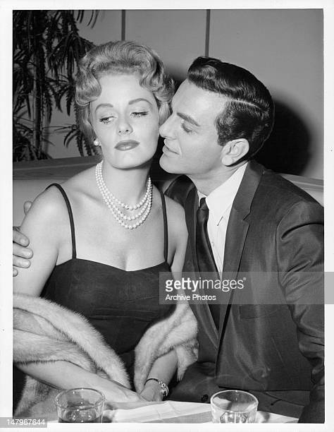 Ann McCrea turning her head as Mike Connors moves in for a kiss in the 'Getaway Day' episode from the television series 'Tightrope' 1959