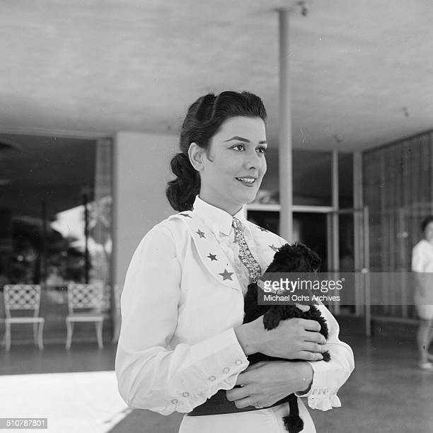 Ann Miller carries her little dog in Los AngelesCA